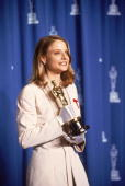 Dorothy Chandler Pavilion Los Angeles California American actress Jodie Foster poses backstage with her 'Oscar' award for Best Actress in a Leading...
