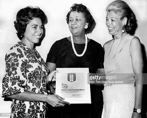 Dorothy Height receives Rural Service Award from Josephine Nieves director of Office of Economic Opportu nity at 72 W 45th St Mrs Polly Cowan watches...