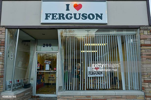 Dorothy Kaiser cleans shop inside the I Love Ferguson store on Monday November 10 in Ferguson MO All proceeds above the cost of the goods sold are...