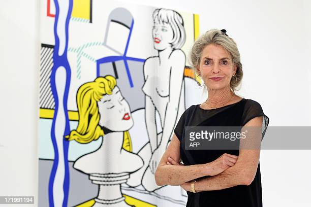 Dorothy Lichtenstein the widow of the US artist Roy Lichtenstein poses next to the artwork entitled 'Nude with Bust' by Roy Lichtenstein on June 30...