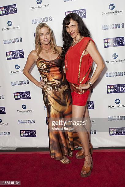 Dorothy Lucey and Neda Soderqvist attend Mending Kids International's Wings Around The World African Safari Gala Red Carpet at Santa Monica Airport...