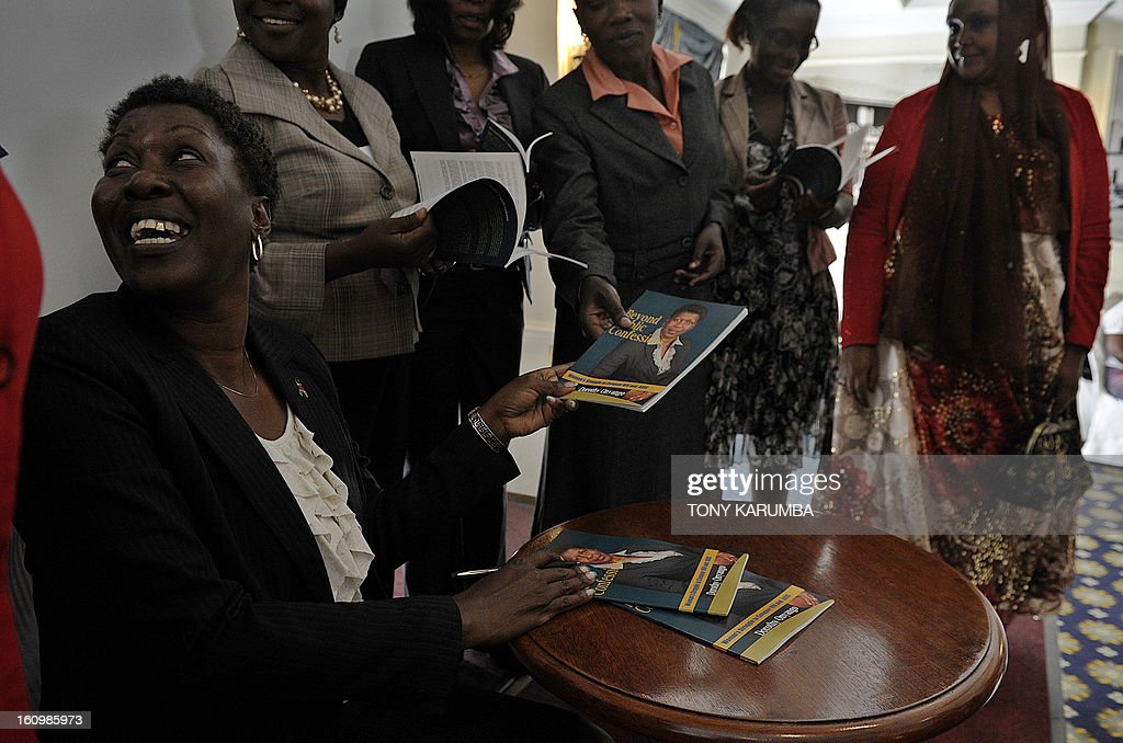 Dorothy Onyango, founder of Women Fighting AIDS in Kenya (WOFAK), signs books at her launch on February 8, 2013 in Nairobi alongside some of the women living positively with HIV and AIDS who's testimonies are featured in the literary work. Onyango, who lives with HIV, said she felt robbed after failing to be nominated in the recent political party primaries for the slot of Member of Parliament to represent HIV and AIDS victims in Kenya. She cited a lack of clear definition of people living with HIV as a special interest group in the country's new constitution as the greatest challenge in achieving equal representation in national governance as she launched her book, entitled 'Beyond public confessions - Woman's struggle to conquer HIV and AIDS' which is a collection of testimonies of challenges faced by affected women in society and elective politics circles. AFP PHOTO/Tony KARUMBA