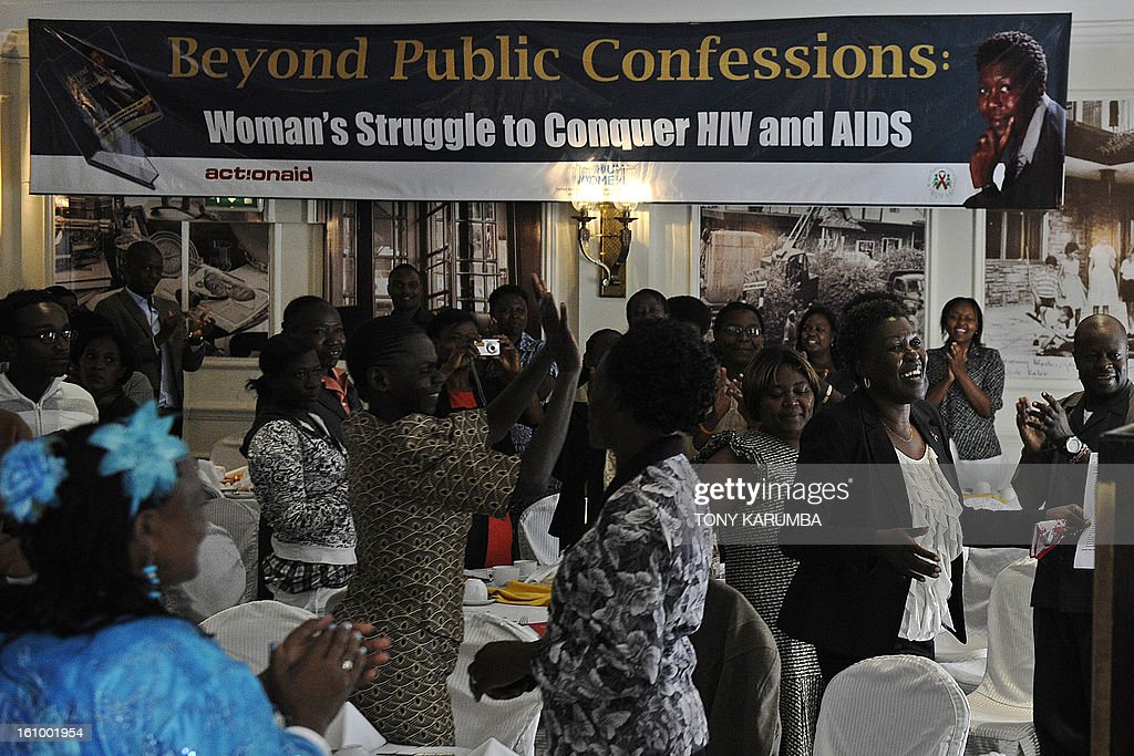 Dorothy Onyango (3rd R), founder of Women Fighting AIDS in Kenya (WOFAK), smiles at her launch on February 8, 2013 in Nairobi alongside some of the women living positively with HIV and AIDS who's testimonies are featured in the literary work. Onyango, who lives with HIV, said she felt robbed after failing to be nominated in the recent political party primaries for the slot of Member of Parliament to represent HIV and AIDS victims in Kenya. She cited a lack of clear definition of people living with HIV as a special interest group in the country's new constitution as the greatest challenge in achieving equal representation in national governance as she launched her book, entitled 'Beyond public confessions - Woman's struggle to conquer HIV and AIDS' which is a collection of testimonies of challenges faced by affected women in society and elective politics circles. AFP PHOTO/Tony KARUMBA