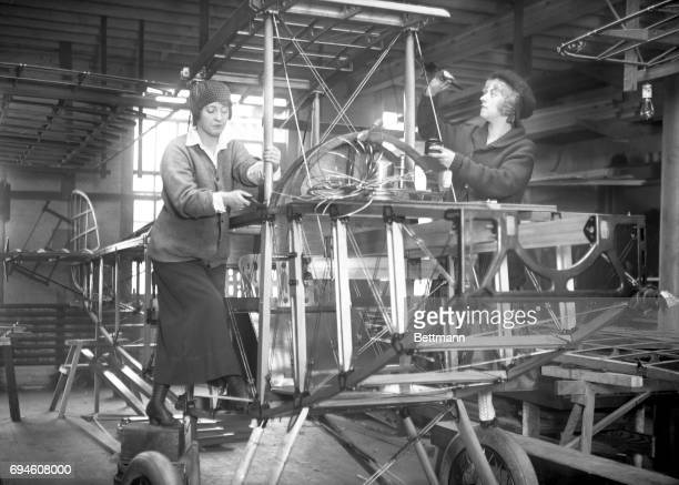 Dorothy Webb and Renee Davis working on Airplanes First women aircraft mechanics when they have no matinee to play members of 'Canary cottage'...