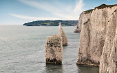 Chalk cliffs and stacks with Swanage on the horizon.