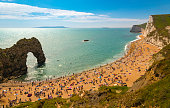 Jurassic coastline with bright blue green sea, deep blue skies and yellow sands and cliffs around the Lulworth, Durdle Door, Worbarrow beaches and coves