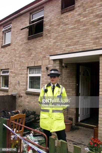 A Dorset Police officer outside the home of Tracey Gallagher in Bournemouth after three of her four children died in a fire which destroyed the...