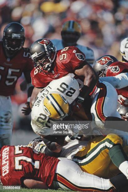 Dorsey Levens Running Back for the Green Bay Packers is tackled by Hardy Nickerson Linebacker for the Tampa Bay Buccaneers during their National...