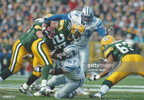 Dorsey Levens Running Back for the Green Bay Packers is tackled by Stephen Boyd Linebacker for the Detroit Lions whilst running the ball during their...