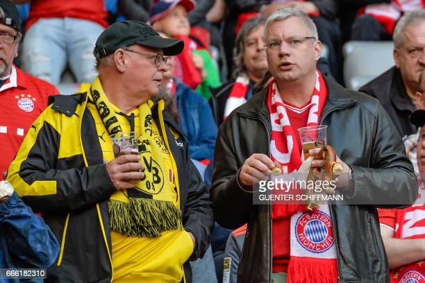 A Dortmund and a Bayern Munich fan chat prior to the German first division Bundesliga football match FC Bayern Munich v BVB Borussia Dortmund in...