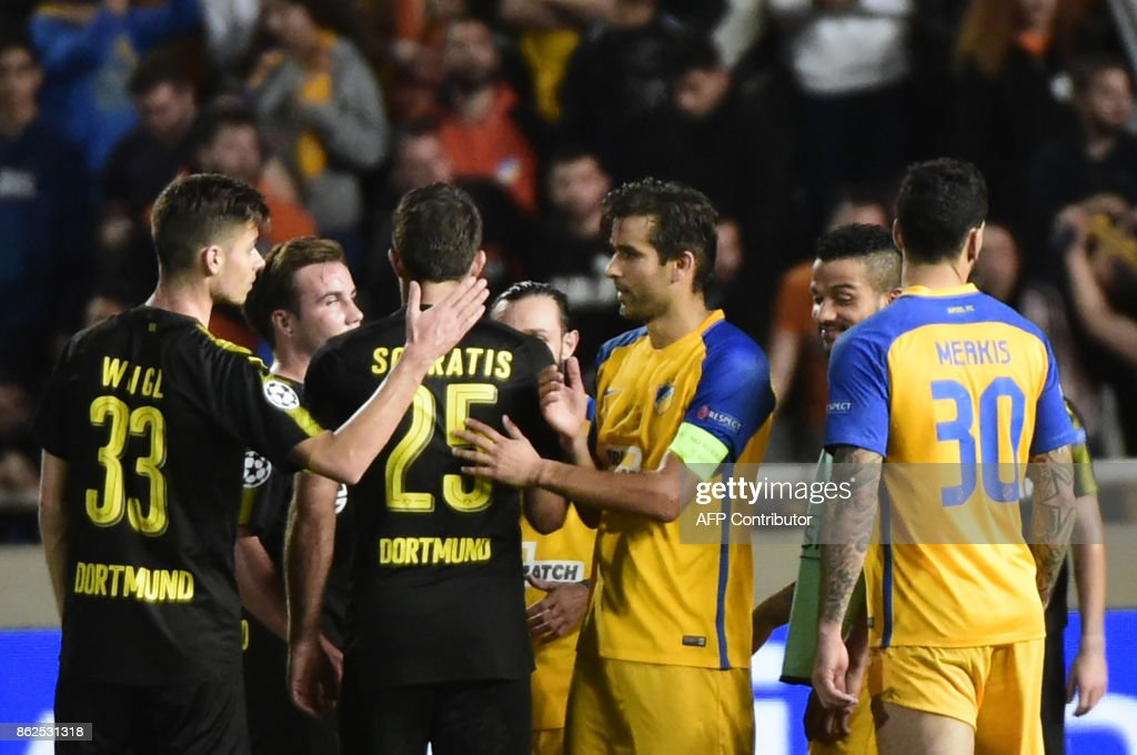 Dortmund and APOEL players greet each other at the end of the UEFA Champions League football match between Apoel FC and Borussia Dortmund at the GSP Stadium in the Cypriot capital, Nicosia on October 17, 2017. /