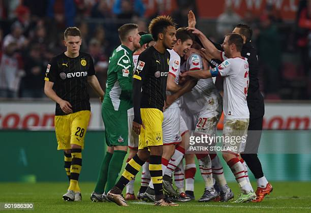 Dortmund and Cologne players react after the German first division Bundesliga football match 1 FC Cologne vs Borussia Dortmund in Cologne western...