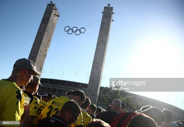 Dortmund and Frankfurt fans enjoy the atmosphere ahead of the DFB Cup final match between Eintracht Frankfurt and Borussia Dortmund at Olympiastadion...