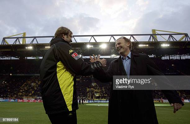 Dortmund coach Juergen Klopp shakes hand with Borussia Dortmund CEO HansJoachim Watzke ahead the Bundesliga match between Borussia Dortmund and Bayer...