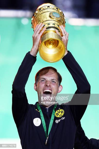 Dortmund corch Thomas Tuchel celebrate with the trophy during at Olympiastadion on May 27 2017 in Berlin Germany