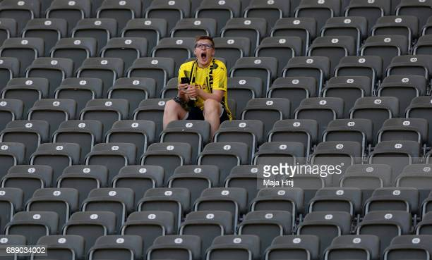 Dortmund fan yawns ahead of the DFB Cup final match between Eintracht Frankfurt and Borussia Dortmund at Olympiastadion on May 27 2017 in Berlin...