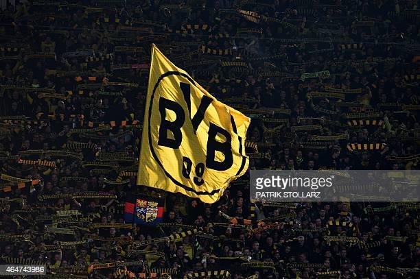 Dortmund fans attend the German first division Bundesliga football match Borussia Dortmund vs FC Schalke 04 in Dortmund western Germany on February...
