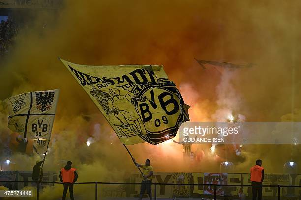 Dortmund fans burn flares ahead of the German Cup DFB Pokal final football match between BVB Borussia Dortmund and VfL Wolfsburg in Berlin on May 30...