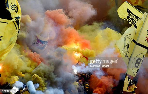 Dortmund fans burn flares during the DFB Cup Final match between Borussia Dortmund and VfL Wolfsburg at Olympiastadion on May 30 2015 in Berlin...