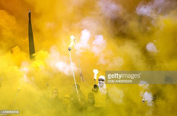 Dortmund fans burn flares during the German Cup DFB Pokal final football match between BVB Borussia Dortmund and VfL Wolfsburg at the Olympic Stadium...