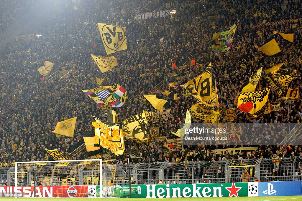 Dortmund fans cheer on their team during the UEFA Champions League Group D match between Borussia Dortmund and Galatasaray AS at Signal Iduna Park on...