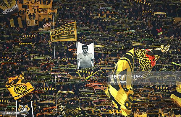Dortmund fans commemorate former player Aki Schmidt before the Bundesliga match between Borussia Dortmund and Bayern Muenchen at Signal Iduna Park on...