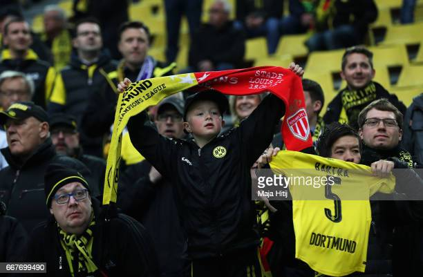 Dortmund fans display a shirt for Marc Bartra who was injured in the team coach attack prior to the UEFA Champions League Quarter Final first leg...