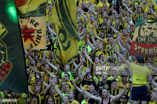 Dortmund fans enjoy the atmosphere ahead of the DFB Cup final match between Eintracht Frankfurt and Borussia Dortmund at Olympiastadion on May 27...