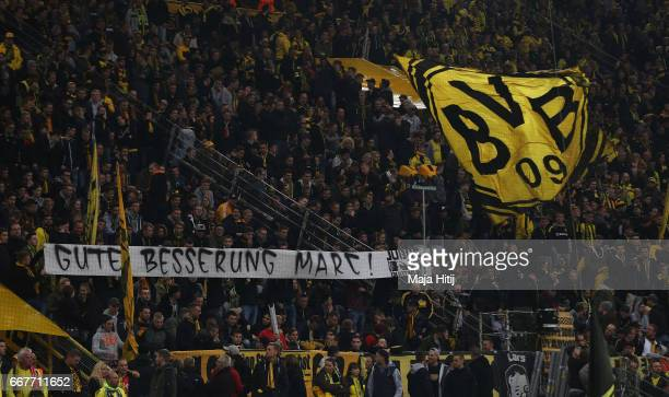 Dortmund fans hold up a banner ahead of the UEFA Champions League Quarter Final first leg match between Borussia Dortmund and AS Monaco at Signal...