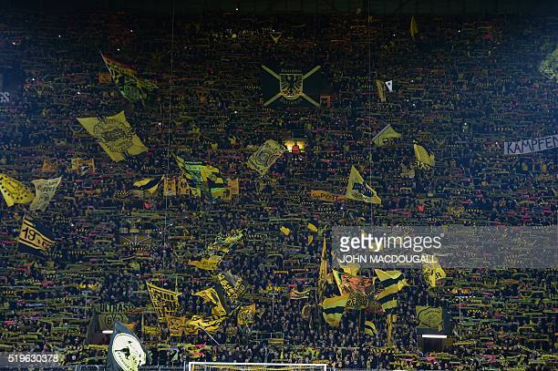Dortmund fans wave their flags prior to the UEFA Europe League quarterfinal firstleg football match Borussia Dortmund vs Liverpool FC in Dortmund...