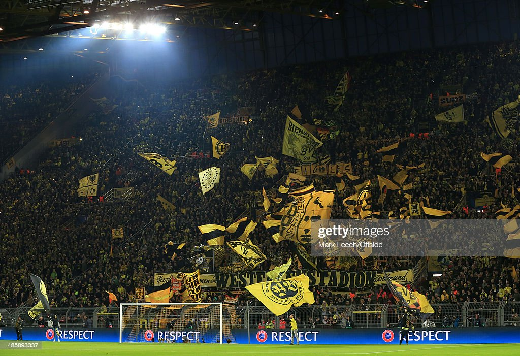 dortmund-fans-wave-their-yellow-flags-and-banners-before-the-uefa-picture-id485893337
