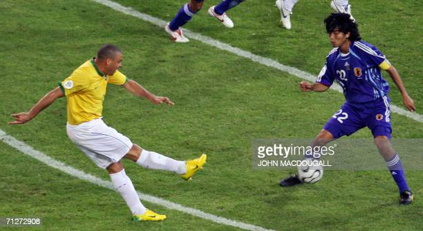 Brazilian forward Ronaldo shoots and scores during the opening round Group F World Cup football match Japan vs Brazil 22 June 2006 in Dortmund...