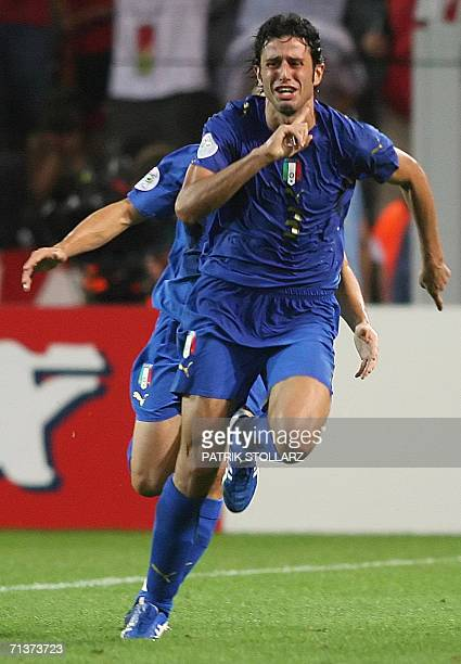 Italian defender Fabio Grosso celebrates his goal in extra time during the semifinal World Cup football match between Germany and Italy at Dortmund's...
