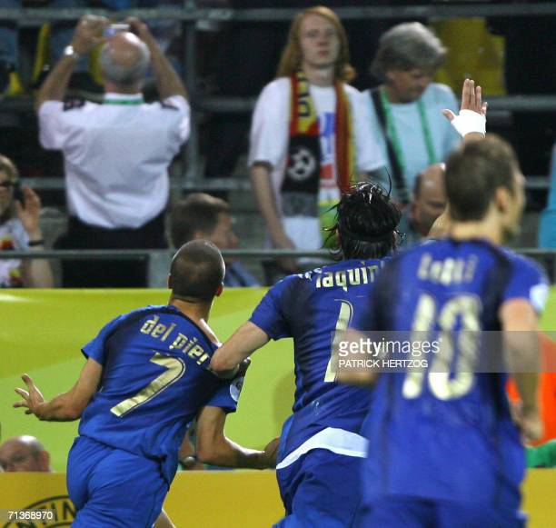 Italian forward Alessandro Del Piero celebrates his goal with his teammates Vincenzo Iaquinta and Francesco Totti during the World Cup 2006 semi...