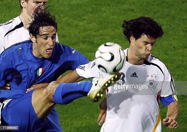 Italian forward Luca Toni tries to control the ball beside German midfielder Michael Ballack during the World Cup 2006 semi final football game...