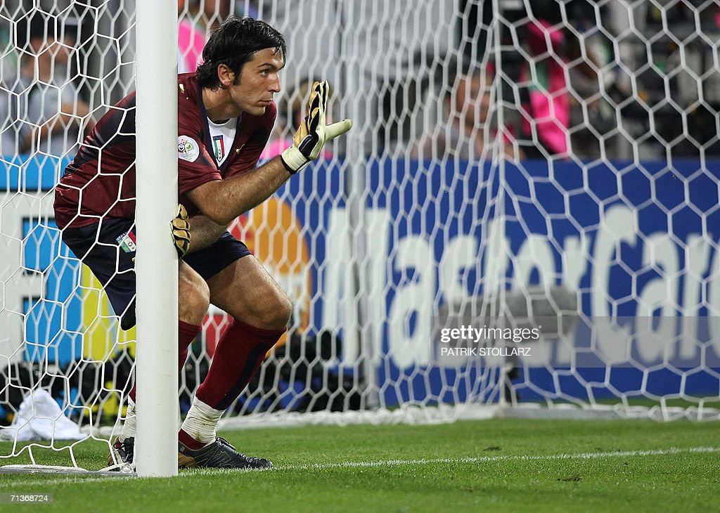 Italian goalkeeper Gianluigi Buffon gives directions to his teammates at the barrier during the World Cup 2006 semi final football game Germany vs...