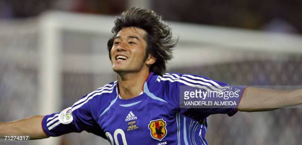 Japanese forward Keiji Tamada celebrates after scoring during the opening round Group F World Cup football match Japan vs Brazil 22 June 2006 in...