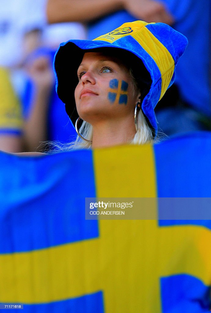 Swedish football supporters wave flags as they wait in the stands in Dortmund Stadium 10 June 2006 prior to the 2006 World Cup group B match between...