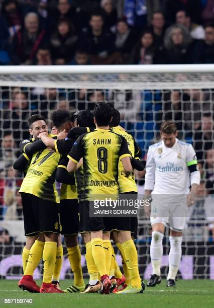 Dortmund players celebrate their second goal during the UEFA Champions League group H football match Real Madrid CF vs Borussia Dortmund at the...