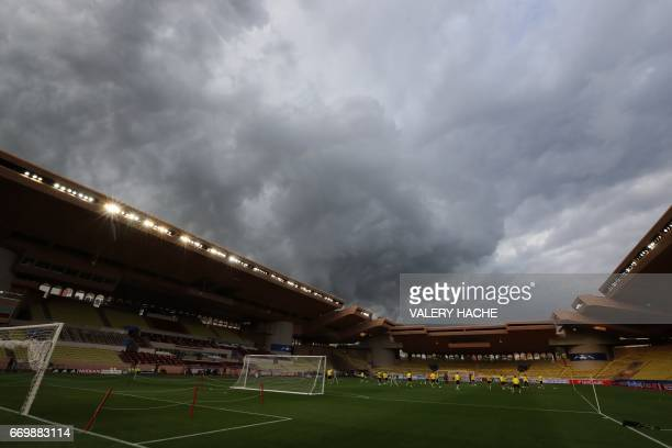 Dortmund players play on the pitch during a training session on the eve of the UEFA Champions League football match Monaco vs Dortmund on April 18...
