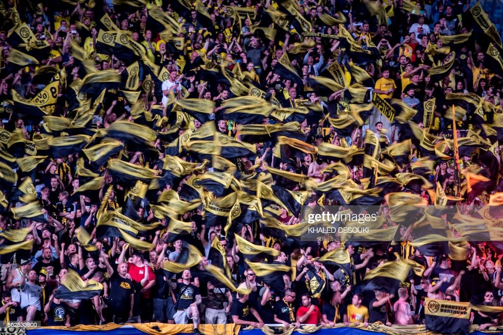 Dortmund supporters cheer for their team during the UEFA Champions League football match between Apoel FC and Borussia Dortmund at the GSP Stadium in the Cypriot capital, Nicosia on October 17, 2017. /