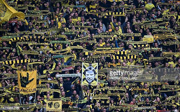 Dortmund supporters hold a placard showing Dortmund's head coach Juergen Klopp prior to the German first division Bundesliga football match between...