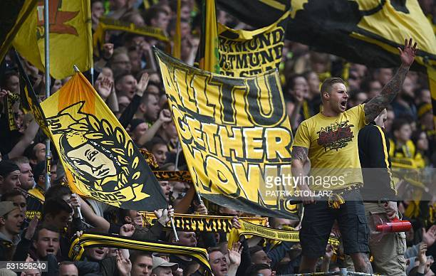 Dortmund supporters react during the German first division Bundesliga football match between Borussia Dortmund and 1 FC Cologne in Dortmund western...