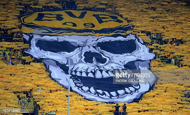 Dortmund supporters show a big display with a skull on it before the German first division Bundesliga football match Borussia Dortmund vs VfL...