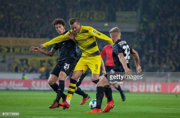 Dortmunds Andrej Yarmolenko in a duel with Stuttgarts Benjamin Pavard and Andreas Beck during the Bundesliga match between VfB Stuttgart and Borussia...