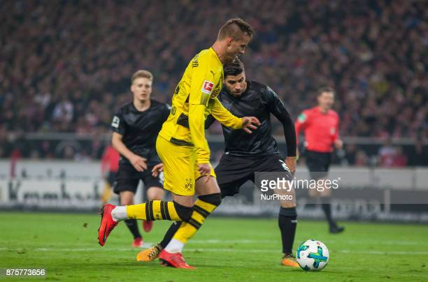 Dortmunds Andrej Yarmolenko in a duel with Stuttgarts Emiliano Insua during the Bundesliga match between VfB Stuttgart and Borussia Dortmund at...