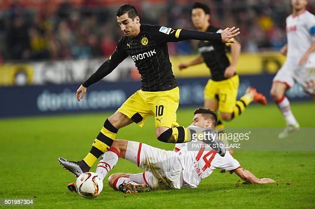Dortmund's Armenian midfielder Henrikh Mkhitaryan and Cologne's defender Jonas Hector vie for the ball during the German first division Bundesliga...