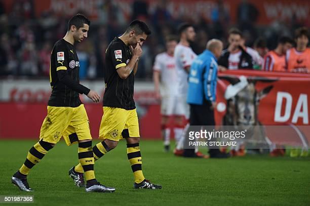 Dortmund's Armenian midfielder Henrikh Mkhitaryan and Dortmund's midfielder Ilkay Guendogan react after the German first division Bundesliga football...