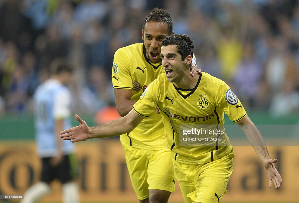 Dortmund's Armenian midfielder Henrikh Mkhitaryan (R) and Dortmund's Gabonese striker Pierre-Emerick Aubameyang (L) celebrate after the second goal during the second round football match of the German Cup (DFB - Pokal) TSV 1860 Munich vs Borussia Dortmund on September 24, 2013 in Munich, southern Germany. DURING THE MATCH AND PROHIBITS MOBILE (MMS) USE DURING AND FOR FURTHER TWO HOURS AFTER THE MATCH. FOR MORE INFORMATION CONTACT DFL