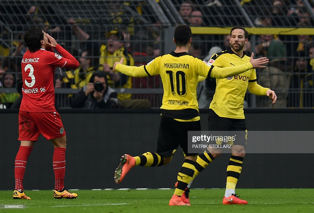 Dortmund's Armenian midfielder Henrikh Mkhitaryan and his teammates celebrate scoring during the German first division Bundesliga football match of Borussia Dortmund vs Hannover 96 in Dortmund, western Germany, on February 13, 2016. / AFP / PATRIK STOLLARZ /